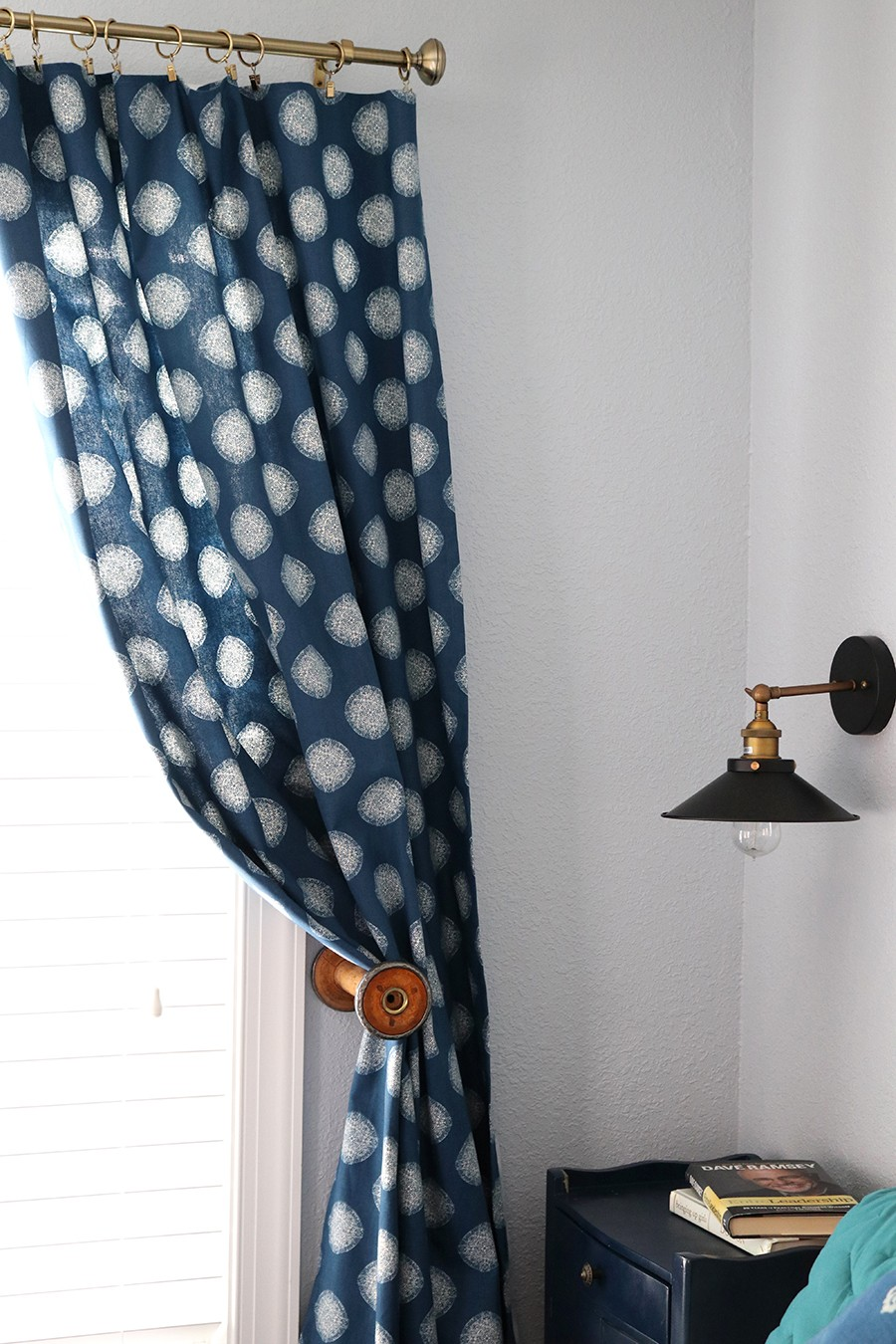 different curtain tie back ideas: use a vintage thread spool!!!